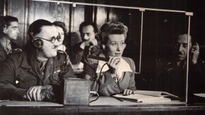 Man and woman using SI equipment at Nuremberg Trials. Digital Image. PRI. Web. 5 September 2017. <https://www.pri.org>